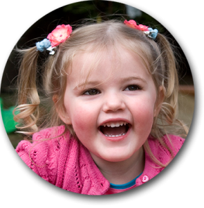Smiling child with bunches in her hair